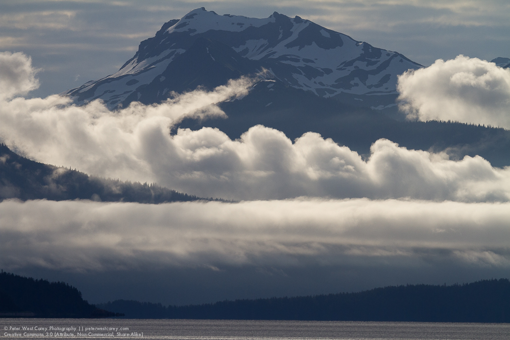 Distant mountain and clouds in Alaska's Inside Passage