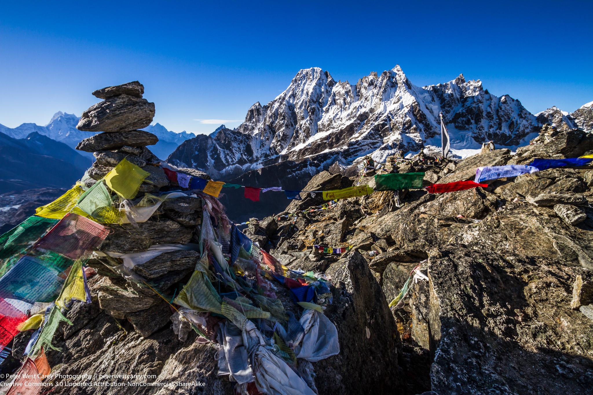 Prayer Flags And The Machermo Range From Gokyo Ri, Nepal