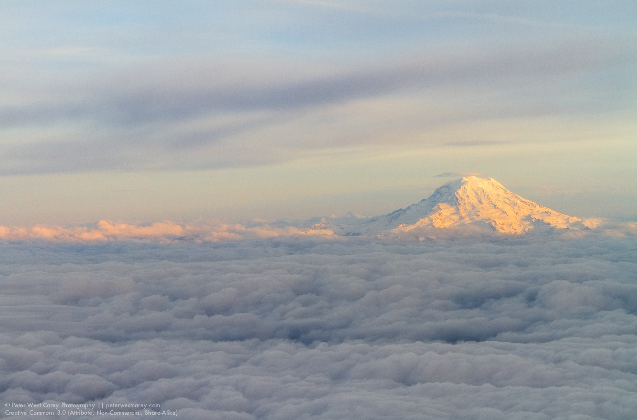 Mount Rainier At Sunset Above The Clouds